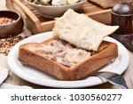 coffin bread is a famous snack... | Shutterstock . vector #1030560277