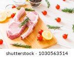fresh pork chop raw with... | Shutterstock . vector #1030563514