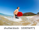 young man with boogie board at... | Shutterstock . vector #103056971
