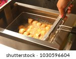 fry the meatballs in hot... | Shutterstock . vector #1030596604