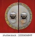 on the red door of the beast... | Shutterstock . vector #1030606849