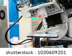 robot arm finishing automotive... | Shutterstock . vector #1030609201