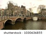 a bridge over a canal in... | Shutterstock . vector #1030636855