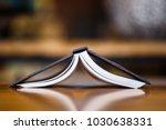 closeup hardcover pocket book...   Shutterstock . vector #1030638331