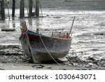 old fishing boat on coast   Shutterstock . vector #1030643071