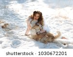 girl with a dog in the winter... | Shutterstock . vector #1030672201