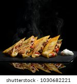 mexican quesadilla wrap with... | Shutterstock . vector #1030682221