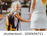 smiling schoolgirl holding... | Shutterstock . vector #1030696711