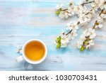 cup of tea and branches of... | Shutterstock . vector #1030703431