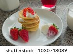 a pile of pancakes with... | Shutterstock . vector #1030718089
