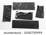 Set of black tapes on white...