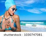 portrait of a woman in a blue... | Shutterstock . vector #1030747081