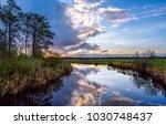 sunset river stream reflection... | Shutterstock . vector #1030748437