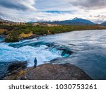 river of baker with mountains... | Shutterstock . vector #1030753261