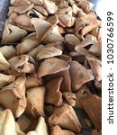 Small photo of Purim traditional food cookies Haman's ear hamantashen Jewish holiday symbol sweet triangle pastry