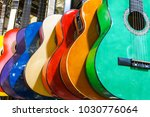 colorful guitars on the... | Shutterstock . vector #1030776064