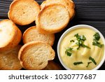 cheese dip sauce with toasted... | Shutterstock . vector #1030777687