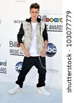 LAS VEGAS - MAY 20:  Justin Bieber arrives at the 2012 Billboard Awards at MGM Garden Arena on May 20, 2012 in Las Vegas, NV - stock photo