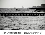 Small photo of Black and white photograph of a jetty of a beach on the sea that expresses nostalgia and arouses memories