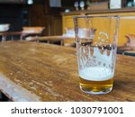 beer glass left on a bar table | Shutterstock . vector #1030791001