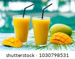 fresh tropical fruit smoothie... | Shutterstock . vector #1030798531