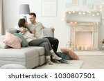young couple spending time... | Shutterstock . vector #1030807501