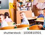boy write in the copybook   Shutterstock . vector #1030810501