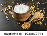 spoon with kernels and corn... | Shutterstock . vector #1030817791
