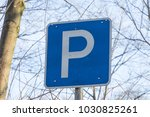 parking sign in a street | Shutterstock . vector #1030825261