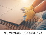 the tile glues the tile to the... | Shutterstock . vector #1030837495