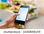 woman using mobile phone while... | Shutterstock . vector #1030848145
