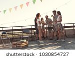 group of young friends having... | Shutterstock . vector #1030854727
