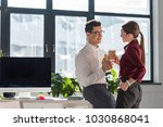 young attractive colleagues... | Shutterstock . vector #1030868041
