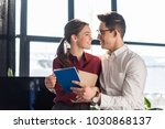attractive young managers... | Shutterstock . vector #1030868137
