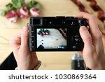 woman's hands keeping camera... | Shutterstock . vector #1030869364