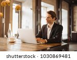 successful young businessman is ... | Shutterstock . vector #1030869481