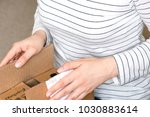 happy excited woman at home ... | Shutterstock . vector #1030883614