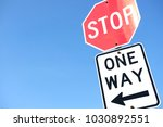 road sign on street and blue... | Shutterstock . vector #1030892551