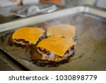 burger on a stove background.... | Shutterstock . vector #1030898779