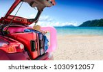summer car with suitcase and... | Shutterstock . vector #1030912057