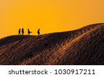 silhouette of people at sand... | Shutterstock . vector #1030917211