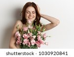 woman with a bouquet of roses ...   Shutterstock . vector #1030920841