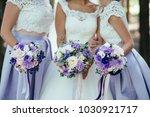 bride and her bridesmaids in... | Shutterstock . vector #1030921717