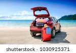 Summer time and red car on beach with few suitcase. Free space for your text or product.  - stock photo