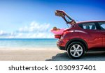 red summer car on beach with... | Shutterstock . vector #1030937401