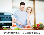 smiling young couple preparing... | Shutterstock . vector #1030951519