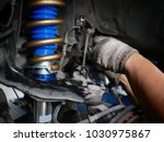 maintaining a car shock absorbers at garage. - stock photo