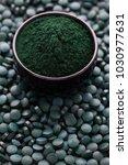 bowls of spirulina algae powder ...   Shutterstock . vector #1030977631