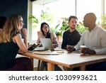 group of focused designers... | Shutterstock . vector #1030993621