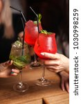 close up of girls drinking... | Shutterstock . vector #1030998259